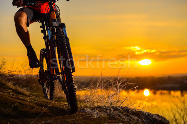 Silhouette of Enduro Cyclist Riding the Mountain Bike on the Rocky Trail at Sunset. Active Lifestyle Stock photo © maxpro