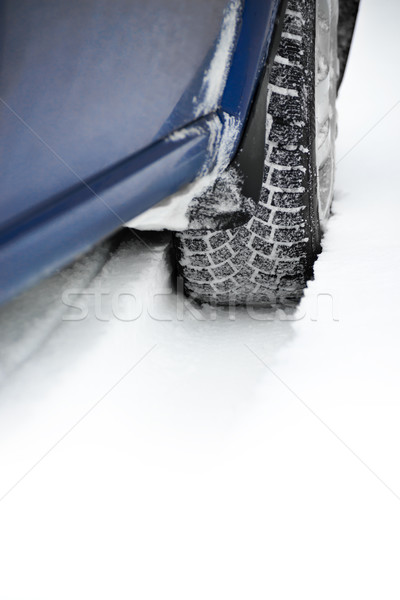 Stock photo: Close-up Image of Winter Car Tire on Snowy Road. Drive Safe Concept