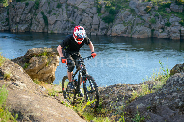 Professional Cyclist Riding the Bike on the Beautiful Spring Mountain Trail. Extreme Sports Stock photo © maxpro