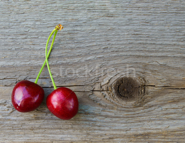 Two Fresh Ripe Red Sweet Cherries on Wooden Background Stock photo © maxpro