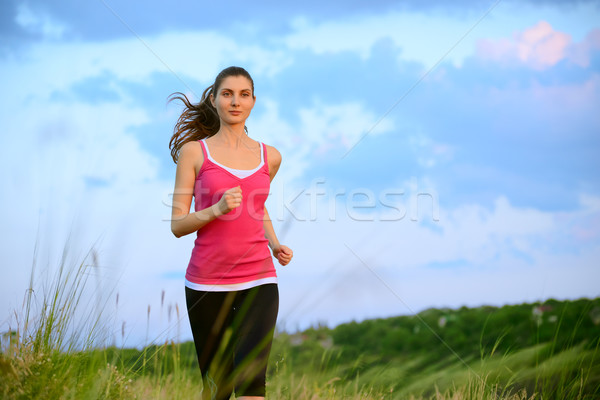 Young Beautiful Woman Running on Mountain Trail in the Morning Stock photo © maxpro