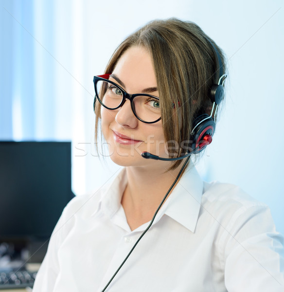 Young Attractive Smiling Customer Support Phone Operator with Headset in Office. Stock photo © maxpro