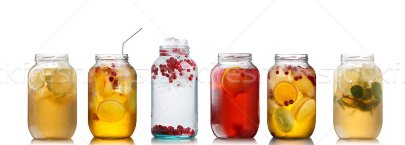 Cold beverages in pitchers Stock photo © maxsol7