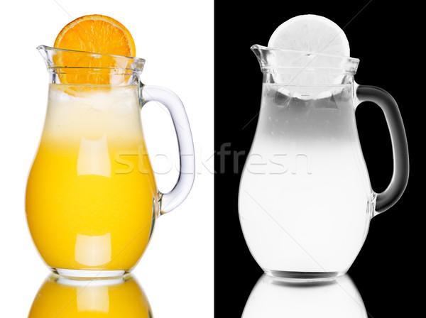 Narancs limonádé díszített narancsszelet kancsó tele Stock fotó © maxsol7