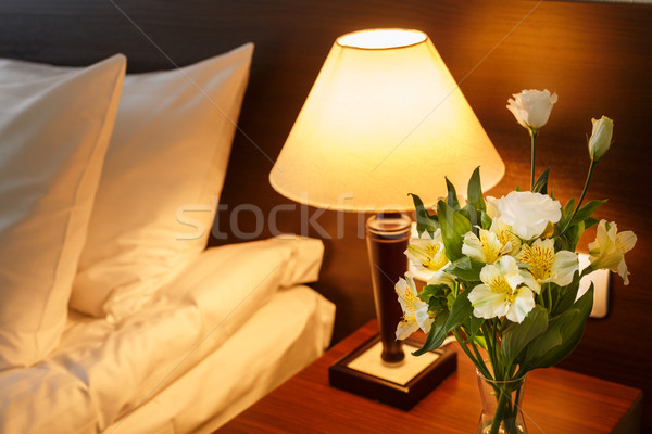 Headboard with flowers and pool of light Stock photo © maxsol7
