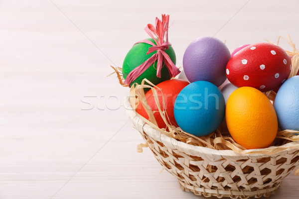 Easter eggs in a weaved basket Stock photo © maxsol7