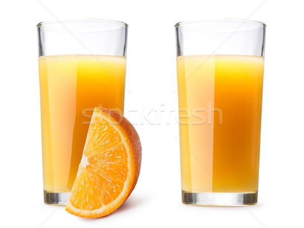 Glasses with fresh orange juice Stock photo © maxsol7