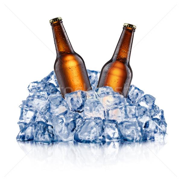 Dois resfriamento cerveja garrafas marrom para baixo Foto stock © maxsol7
