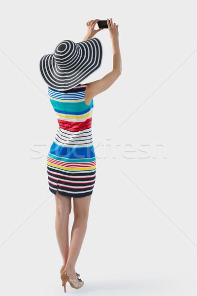 Woman photographing mockup, full length Stock photo © maxsol7