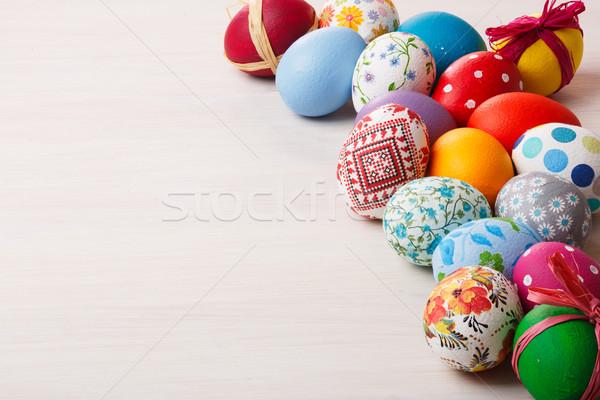 красочный окрашенный пасхальных яиц деревянный стол Пасху зеленый Сток-фото © maxsol7