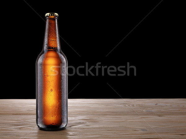 Beer bottle on wooden table mockup Stock photo © maxsol7