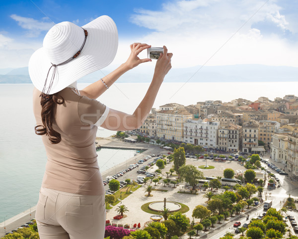 Woman photographing Corfu town Stock photo © maxsol7