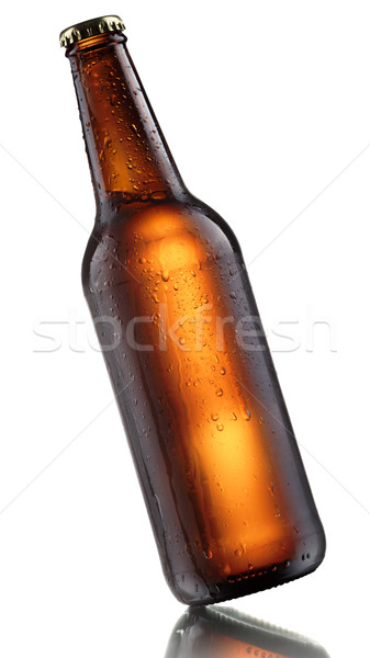 Swinging beer bottle Stock photo © maxsol7