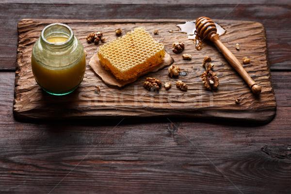 Mel molho favo de mel Foto stock © maxsol7
