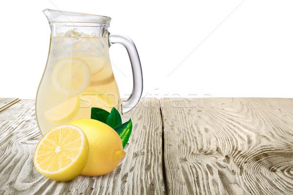Kancsó limonádé citromok előtér áll fa asztal Stock fotó © maxsol7