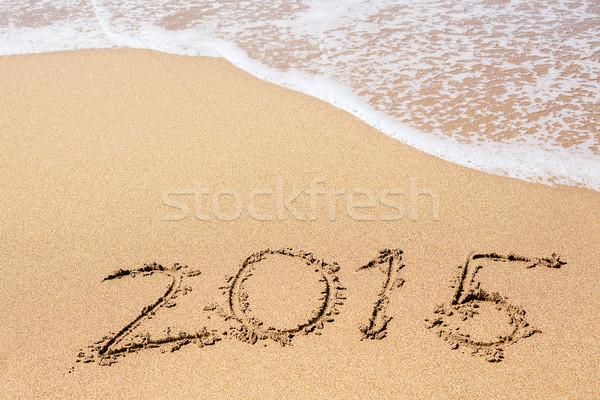 ストックフォト: 碑文 · 2015 · 砂 · ビーチ · 海 · 波