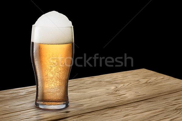 Glass of light beer on wooden table Stock photo © maxsol7