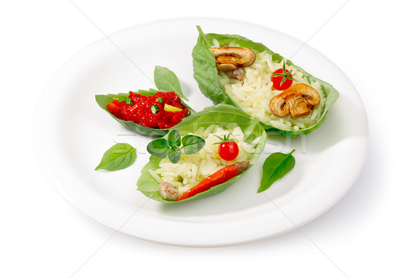 Boiled rice (risotto) served into basil leaves Stock photo © maxsol7
