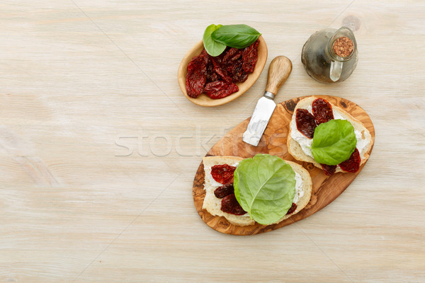 Sandwiches with mascarpone, dried tomatoes, basil Stock photo © maxsol7