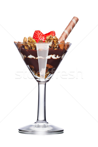 Dessert with nuts and chocolate decorated with strawberry. Sweet food. Parfait Stock photo © maxsol7