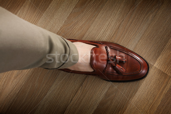 Sockless leg in pants and loafer Stock photo © maxsol7