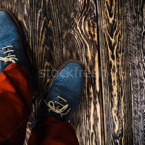 Mavi ayakkabı adam turuncu Stok fotoğraf © maxsol7