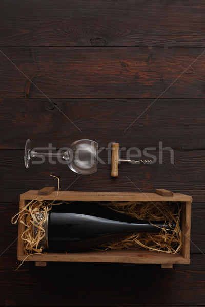 Red wine bottle, glasses, corkscrew, flat lay Stock photo © maxsol7