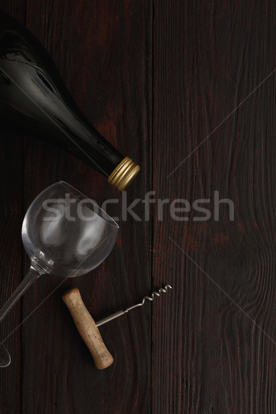 Red wine bottle, glass, corkscrew, flat lay Stock photo © maxsol7