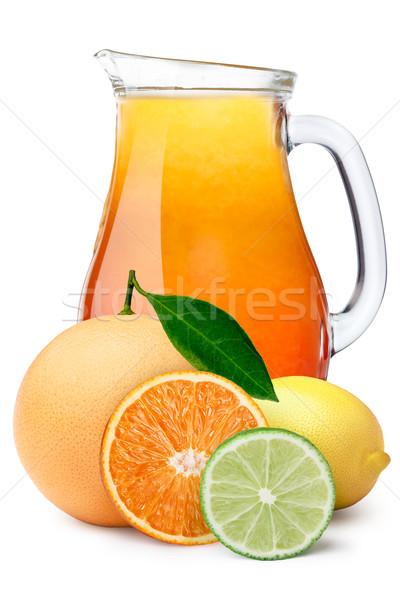 Pitcher of multi-fruit citrus juice Stock photo © maxsol7
