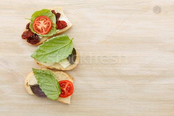 Sanduíches mascarpone secas tomates manjericão sol Foto stock © maxsol7
