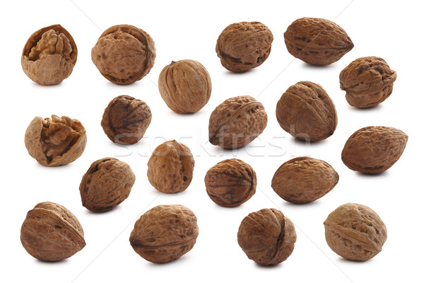 Set of cracked and shelled walnuts Stock photo © maxsol7