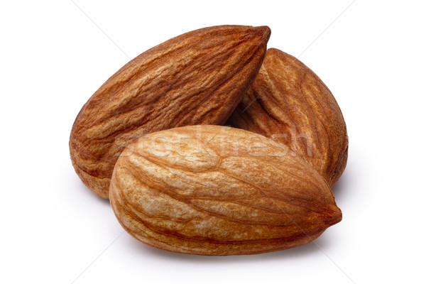 Three almonds isolated Stock photo © maxsol7