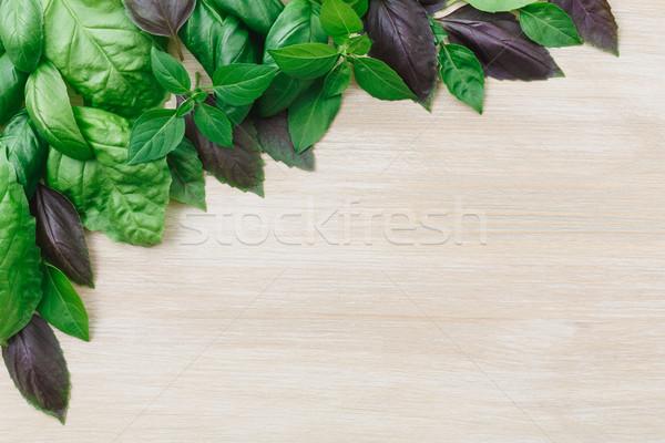 Heirloom basil on wooden table Stock photo © maxsol7