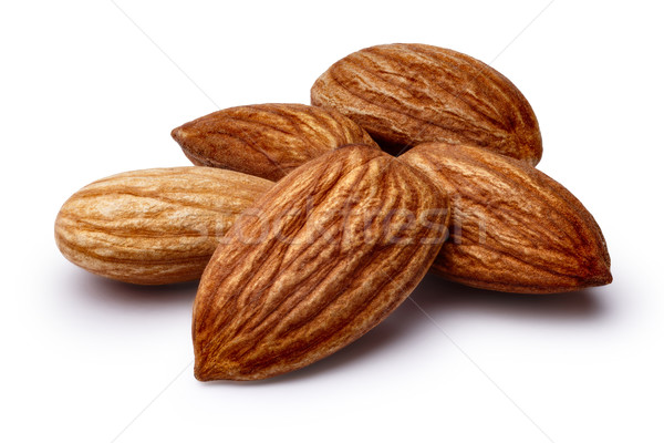 Shelled almonds isolated Stock photo © maxsol7