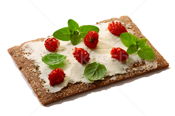 Bread crisp with fresh strawberries, soft cheese and mint Stock photo © maxsol7