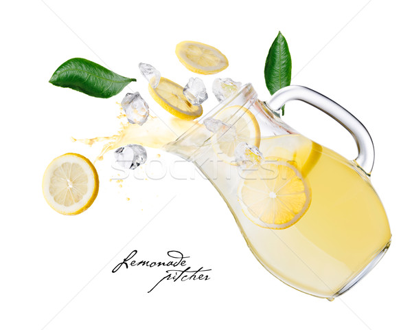 Stock photo: Lemonade pitcher splashes