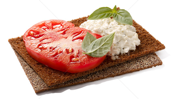 Bread crisps with tomato, cheese and basil Stock photo © maxsol7
