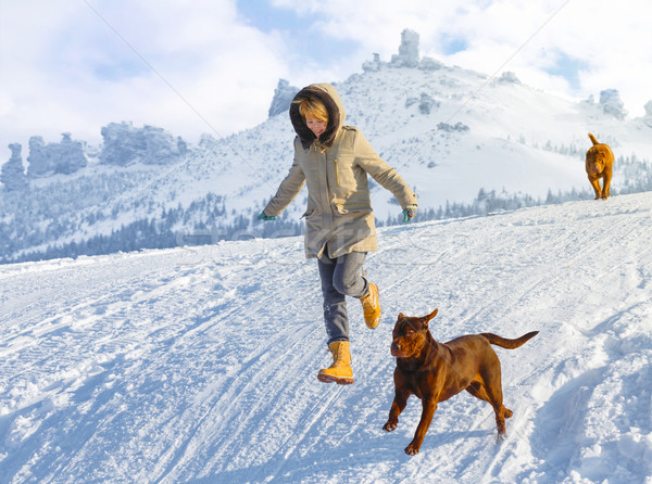 Woman jumping with dogs Stock photo © maxsol7
