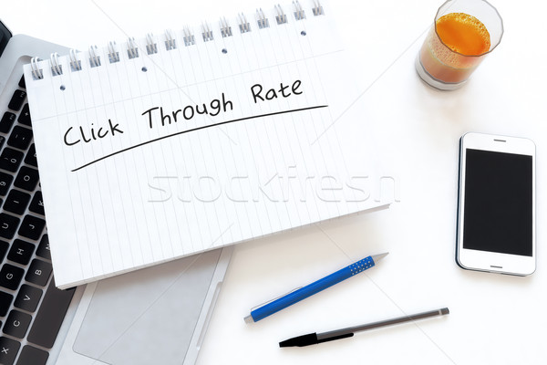 Kliknij tekst notebooka biurko Zdjęcia stock © Mazirama