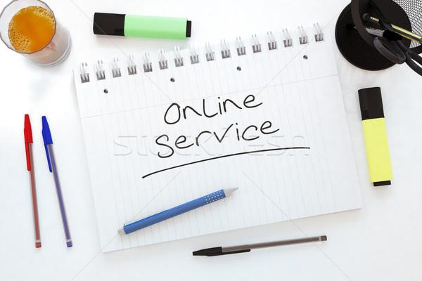 Foto stock: On-line · serviço · texto · caderno · secretária