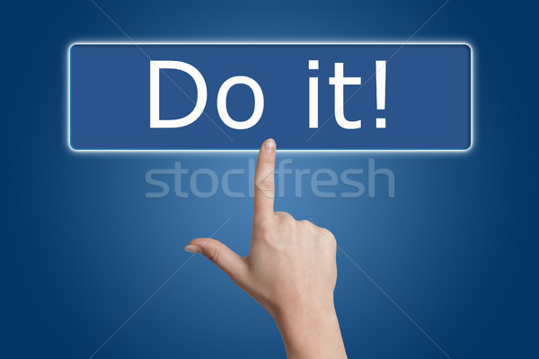Stock photo: pressing do it button