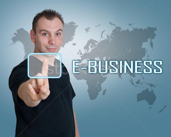 Fiatalember sajtó digitális gomb interfész üzlet Stock fotó © Mazirama