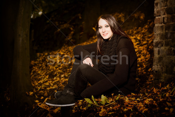 Stock photo: Beautiful woman in autumn leaves