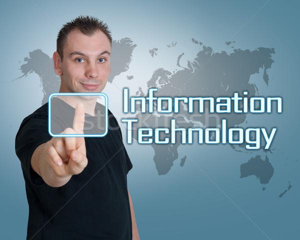 Информационные технологии молодым человеком прессы цифровой кнопки интерфейс Сток-фото © Mazirama