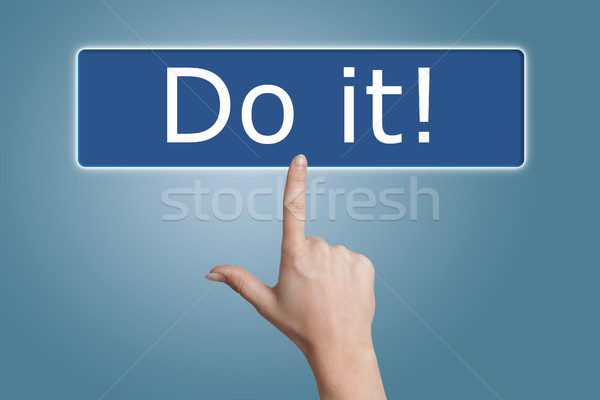pressing do it button Stock photo © Mazirama