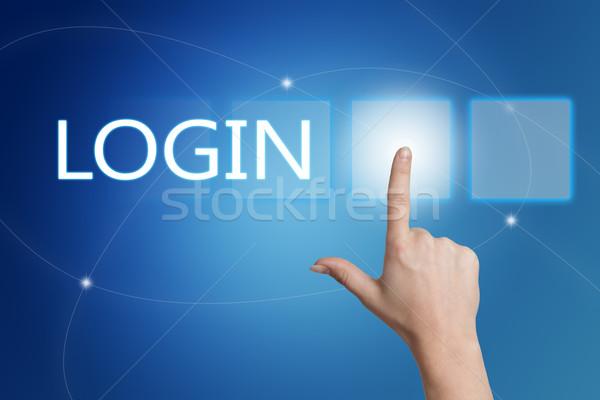 Login mano pulsante interfaccia blu Foto d'archivio © Mazirama