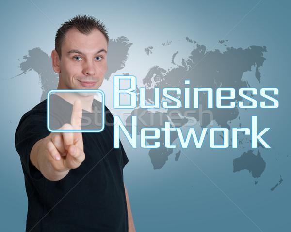 Бизнес-сеть молодым человеком прессы цифровой кнопки интерфейс Сток-фото © Mazirama