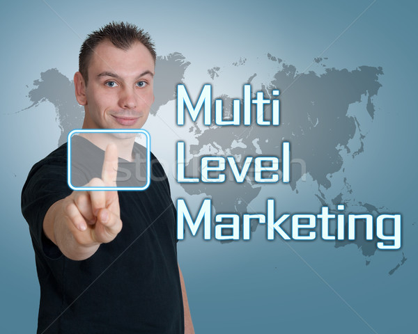 Niveau marketing jeune homme presse numérique bouton Photo stock © Mazirama