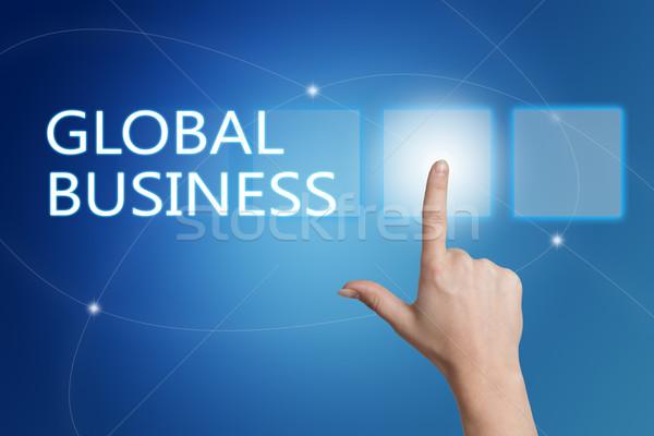 Business globale mano pulsante interfaccia blu Foto d'archivio © Mazirama