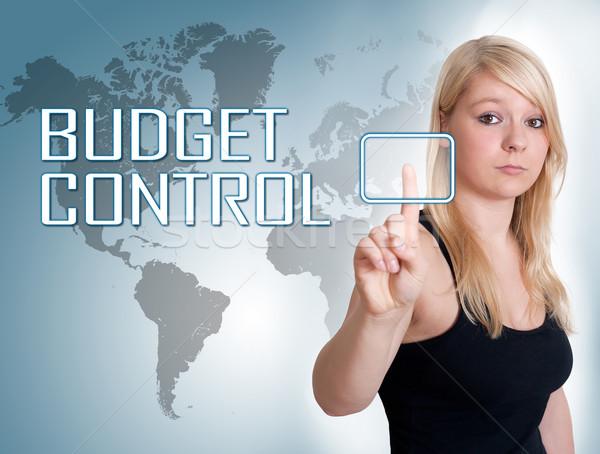 Budget controle jonge vrouw druk digitale knop Stockfoto © Mazirama